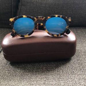 Illesteva sunglasses with blue mirrored lens.